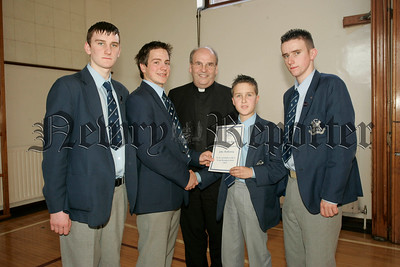 St Colmans College Junior prizegiving. John McAleavey recieves the Art & Design award from Dr Francis Brown. Also in picture are school Prefects, Edward O'Hare, Michael Mulvanny and Gary Buchanan.