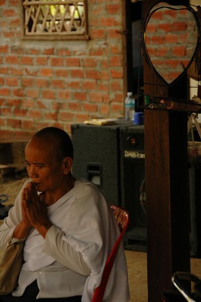 Old Man Saying Prayers - Battambang, Cambodia