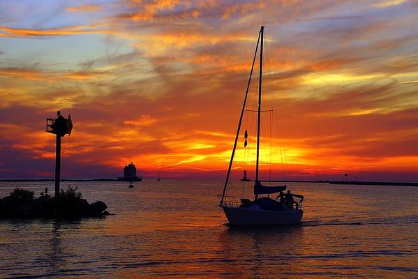 Sailboat at Sunset Lorain Harbor 6-18-2016 Click to see Photos