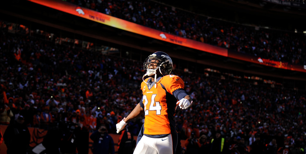 . DENVER, CO - JANUARY 12: Denver Broncos cornerback Champ Bailey (24) takes the field. The Denver Broncos vs. The San Diego Chargers in an AFC Divisional Playoff game at Sports Authority Field at Mile High in Denver on January 12, 2014. (Photo by Joe Amon/The Denver Post)
