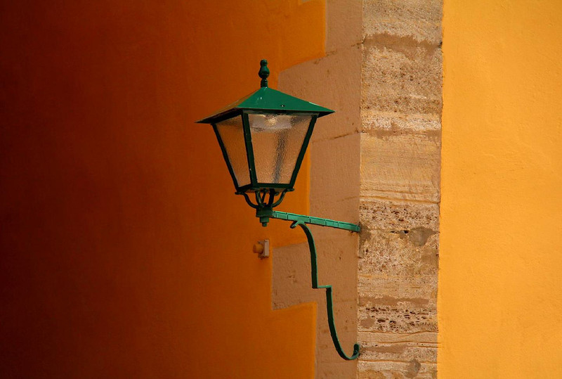 A street lamp in Rothenburg, a medieval city still surrounded completely by the stone wall that protected it in the 14th century.