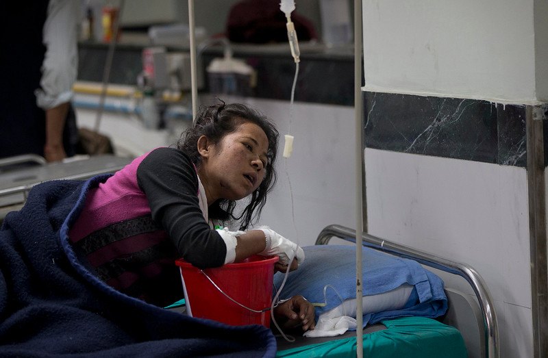 . An earthquake injured woman lies at a hospital ,in Kathmandu, Nepal, Sunday, April 26, 2015. A strong magnitude 7.8 earthquake shook Nepal\'s capital and the densely populated Kathmandu Valley before noon Saturday, causing extensive damage with toppled walls and collapsed buildings, officials said. (AP Photo/Manish Swarup)