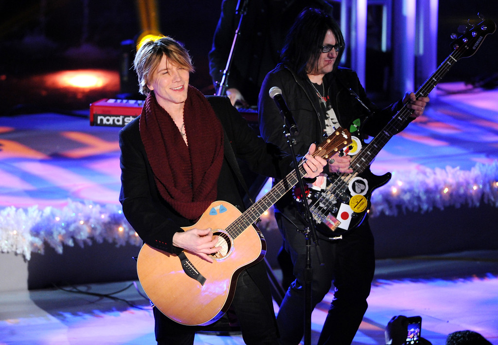 . Musicians John Rzeznik, left, and Robby Takac, right, of The Goo Goo Dolls perform at the 81st annual Rockefeller Center Christmas tree lighting ceremony on Wednesday, Dec. 4, 2013 in New York. (Photo by Evan Agostini/Invision/AP)