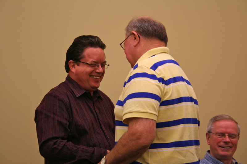 Fr. Jack Kurps receives congratulations from Br. Ray Kozuch on his election.