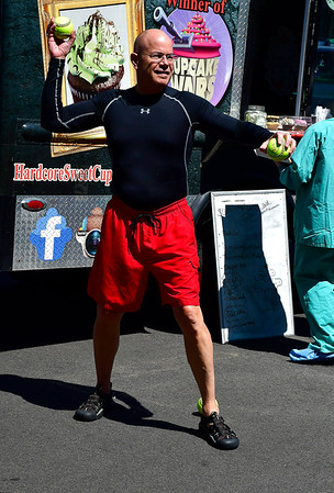 8/29/2019 Mike Orazzi | Staff Kurt A. Barwis, FACHE, President and CEO, of the Bristol Hospital & Health Care Group throws at the dunk tank during the Bristol Hospital Foundation's Food Truck Festival to raise funds for the emergency center renovation and expansion project on Thursday.