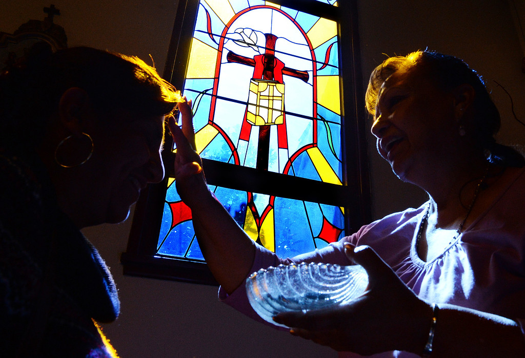 . A parishioner at Our Lady of Carmel Church in Rancho Cucamonga receives ashes on her forehead to mark the beginning of Lent on Ash Wednesday March 5, 2014.  (Will Lester/Inland Valley Daily Bulletin)