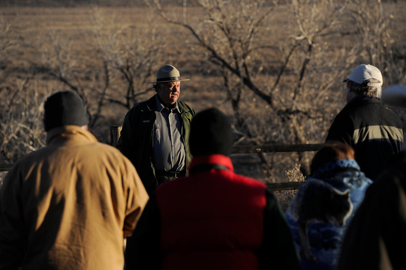 . Folks gather on a chilly morning, November 29th, 2012, at the Sand Creek Massacre National Historic site in Kiowa County Colorado for a sunrise program on 148th anniversary of the massacre. National Park Service Ranger, Craig Moore, second from left,  gave a speech to a handful of people, honoring Chief White Antelope, who was killed along with over 150 Indians November 29th, 1864 by Colorado militiamen. The Denver Post/ Andy Cross