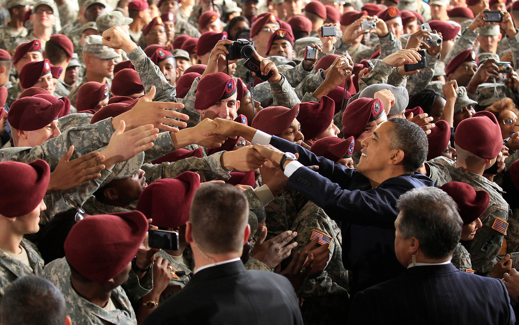 . U.S. President Barack Obama greets troops at Fort Bragg in North Carolina December 14, 2011. The visit was seen as marking the end of the Iraq war with a tribute to the troops who fought and died in a conflict Obama opposed from the start. REUTERS/Kevin Lamarque