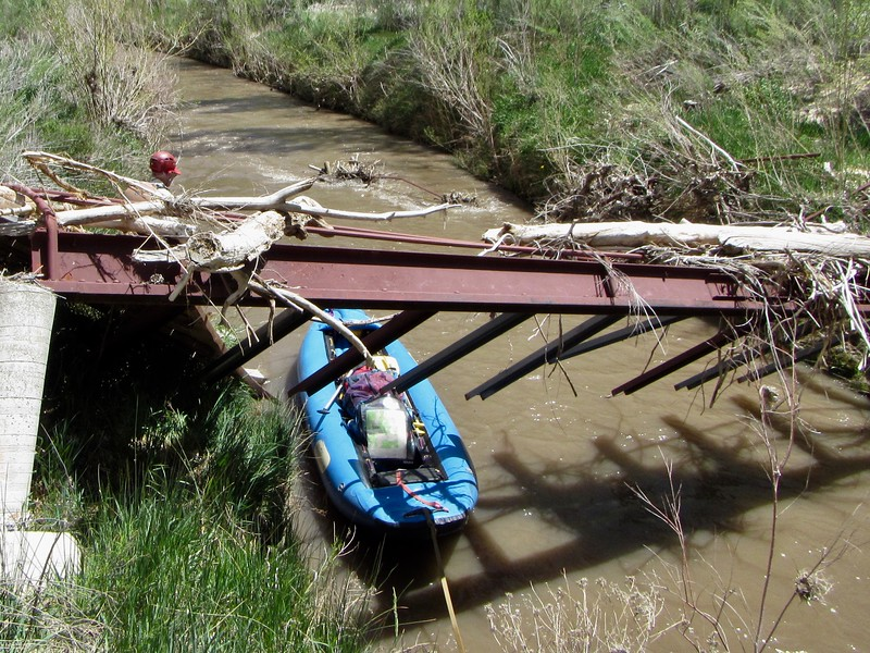 First obstacle to line the boat past was an old, broken private bridge about 15 min. downstream.