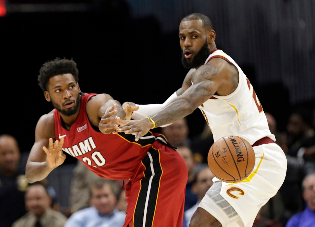 . Miami Heat\'s Justise Winslow (20) passes against Cleveland Cavaliers\' LeBron James (23) in the first half of an NBA basketball game, Tuesday, Nov. 28, 2017, in Cleveland. (AP Photo/Tony Dejak)