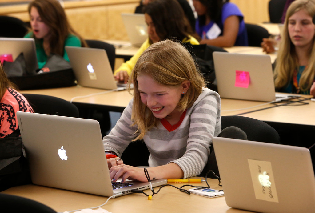 . Middle school student Brielle O\'Connor, from Mountain Views works on a project at the Dare 2B Digital 4th Annual Conference for Young Women.