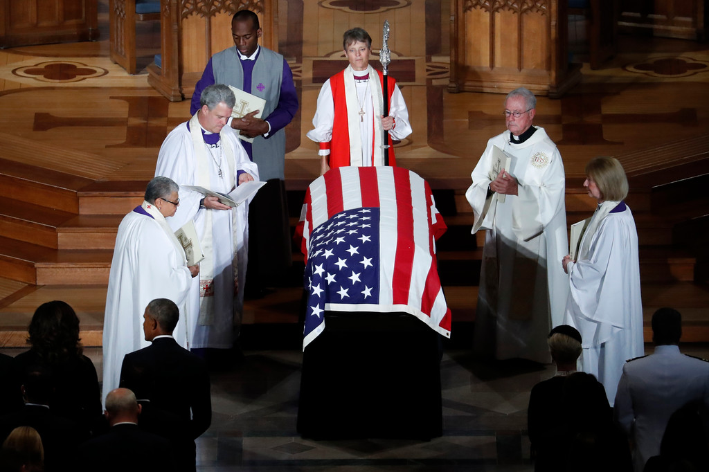 . The casket of Sen. John McCain, R-Ariz., is blessed at the end of a memorial service at Washington National Cathedral in Washington, Saturday, Sept. 1, 2018. McCain died Aug. 25, from brain cancer at age 81. (AP Photo/Pablo Martinez Monsivais)