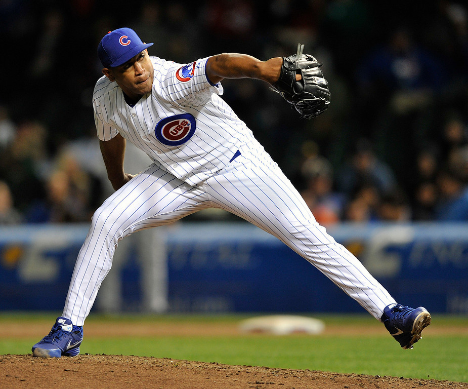 . Chicago Cubs\' Carlos Marmol pitches against the Colorado Rockies during the ninth inning of a baseball game Monday, May 13, 2013, in Chicago. (AP Photo/Jim Prisching)