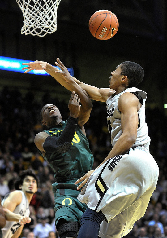 . BOULDER, CO. - MARCH 7: Colorado guard Spencer Dinwiddie (25) knocked the ball from the grasp of Oregon guard Jonathan Loyd (10) in the first half. The University of Colorado men\'s basketball team hosted Oregon Thursday night, March 7, 2013 at the CU Events Center in Boulder. (Photo By Karl Gehring/The Denver Post)