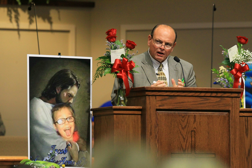 . Tim Marcengill, Associate Pastor Evangelism and Education, speaks at funeral for Jacob Hall at Oakdale Baptist Church on Wednesday, Oct. 5, 2016, in Townville, S.C.  Jacob\'s family has encouraged people to celebrate his life by dressing as the superheroes he loved.  A 14-year-old boy killed his own father, then drove to Townville Elementary and fired on two children and a teacher as recess began.  Jacob died Saturday.  ( Ken Ruinard/The Independent-Mail via AP, Pool)