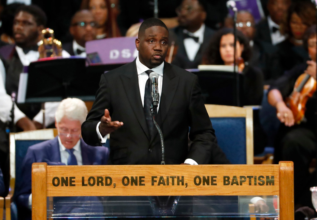 . Pastor Solomon Kinloch speaks during the funeral service for Aretha Franklin at Greater Grace Temple, Friday, Aug. 31, 2018, in Detroit. Franklin died Aug. 16, 2018 of pancreatic cancer at the age of 76. (AP Photo/Paul Sancya)