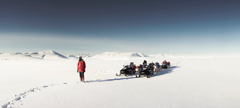 Sledge team on sea ice, Kong Oscar Fjord, North-East Greenland