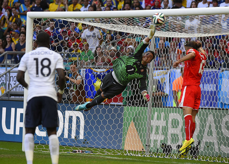 . Switzerland\'s goalkeeper Diego Benaglio fails to stop a ball shot by France\'s forward Olivier Giroud during a Group E football match between Switzerland and France at the Fonte Nova Arena in Salvador during the 2014 FIFA World Cup on June 20, 2014. (FABRICE COFFRINI/AFP/Getty Images)
