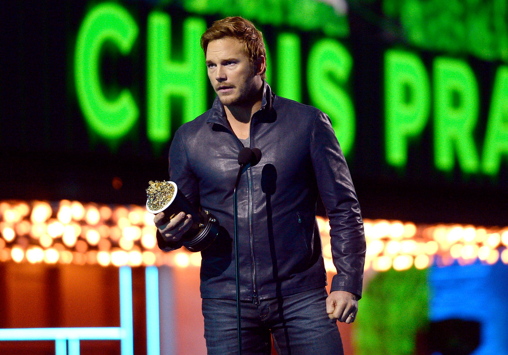 . Chris Pratt accepts the award for best action performance for �Jurassic World� at the MTV Movie Awards at Warner Bros. Studio on Saturday, April 9, 2016, in Burbank, Calif. (Kevork Djansezian/Pool Photo via AP)