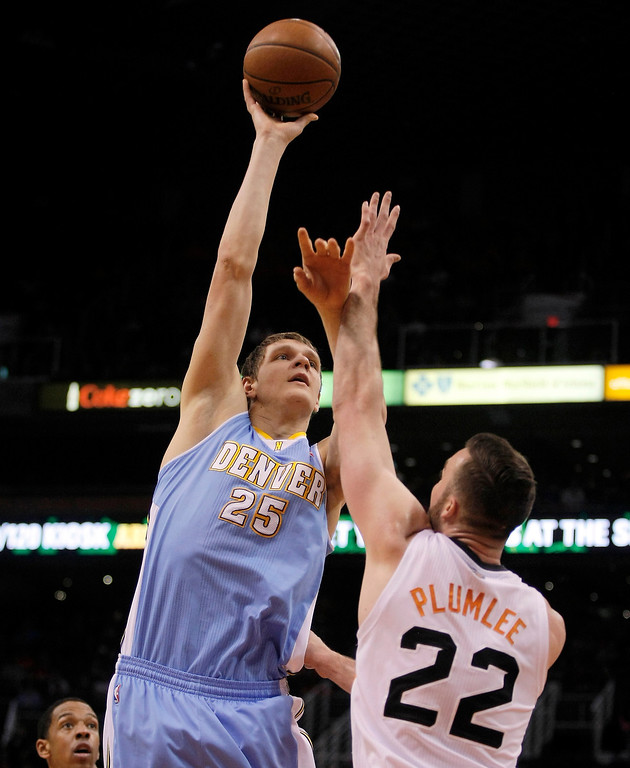 . Denver Nuggets center Timofey Mozgov (25) shoots over Phoenix Suns center Miles Plumlee (22) in the second quarter during an NBA basketball game, Sunday, Jan. 19, 2014, in Phoenix. (AP Photo/Rick Scuteri)