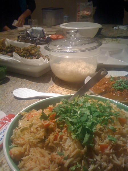 Clockwise from top left: pakora, basmati rice, eggplant masala, and vegetable palau.