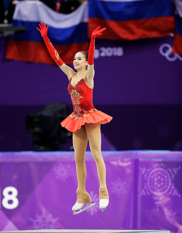 . Alina Zagitova of the Olympic Athletes of Russia celebrates on the podium after winning the gold medal in the women\'s free figure skating final in the Gangneung Ice Arena at the 2018 Winter Olympics in Gangneung, South Korea, Friday, Feb. 23, 2018. (AP Photo/Bernat Armangue)