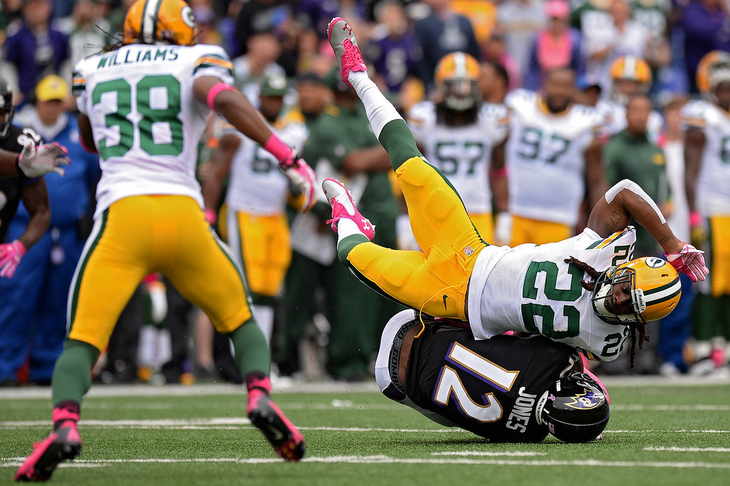 . Wide receiver Jacoby Jones #12 of the Baltimore Ravens is tackled by safety Jerron McMillian #22 of the Green Bay Packers in the first quarter at M&T Bank Stadium on October 13, 2013 in Baltimore, Maryland. (Photo by Patrick Smith/Getty Images)