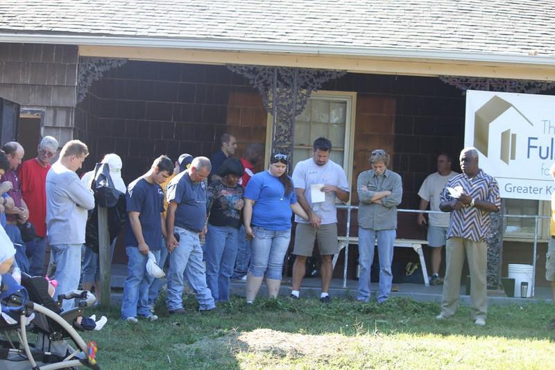 10 10-09 Gathered in prayer before work begins.  rkhiles