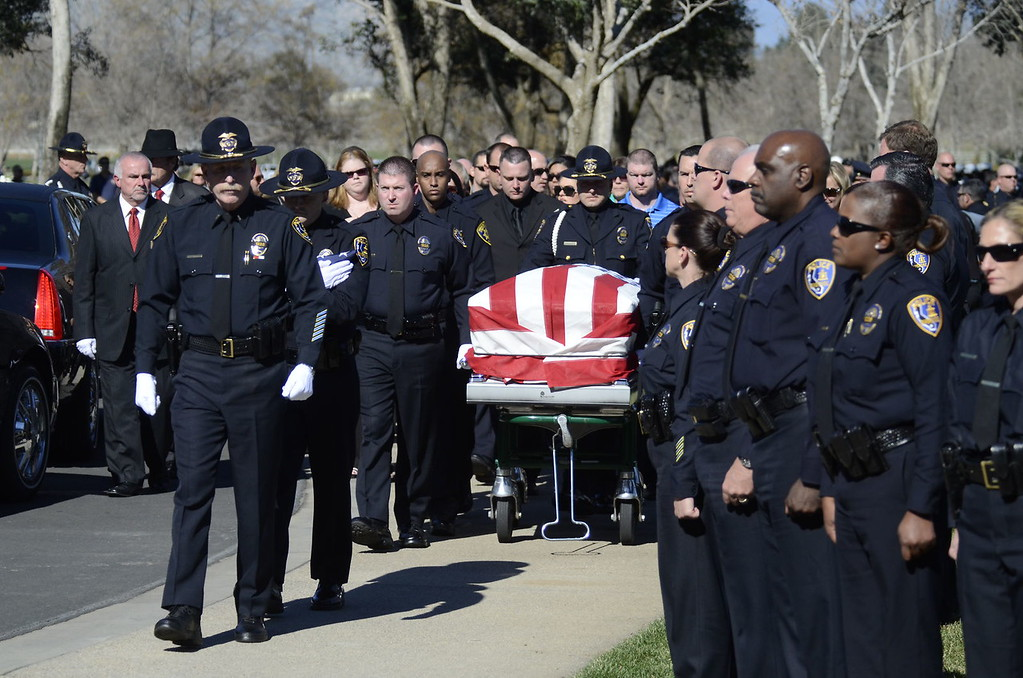 . Family, friends and thousands of people, including law enforcement officials from across the state, arrived at the Grove Community Church this morning to attend the funeral service for Riverside Police Officer Michael Crain. Numerous California law enforcement joined all 400 members of the Riverside Police Department during the procession for Crain, 34, who was killed Feb. 7 when a suspect believed to be Christopher Dorner ambushed him and his partner while on duty.  (Jeff Gritchen/Staff Photographer)