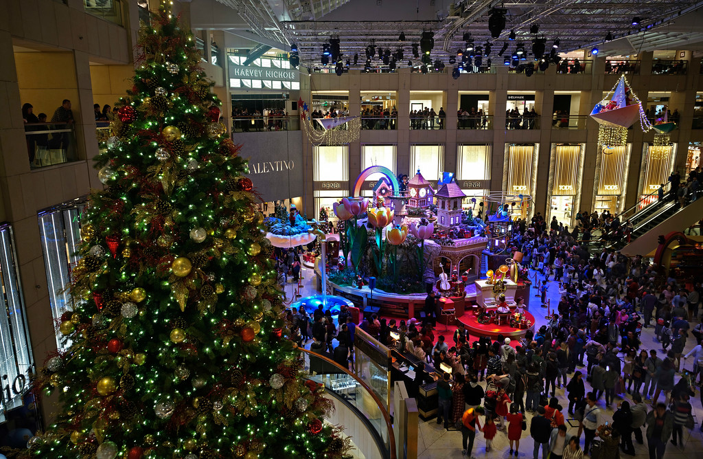 . People stroll at a shopping mall decorated to celebrate the festival season during Christmas eve in Hong Kong, Sunday, Dec. 24, 2017. (AP Photo/Vincent Yu)