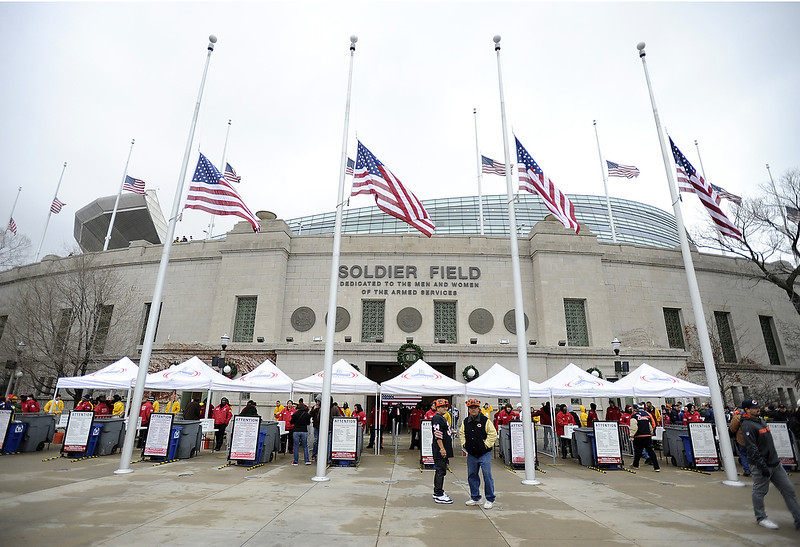 . American flags fly at half staff to honor the fallen victims of the Newtown, CT elementary school shooting massacre before the game between the Chicago Bears and the Green Bay Packers on December 16, 2012 at Soldier Field in Chicago, Illinois. (Photo by David Banks/Getty Images)
