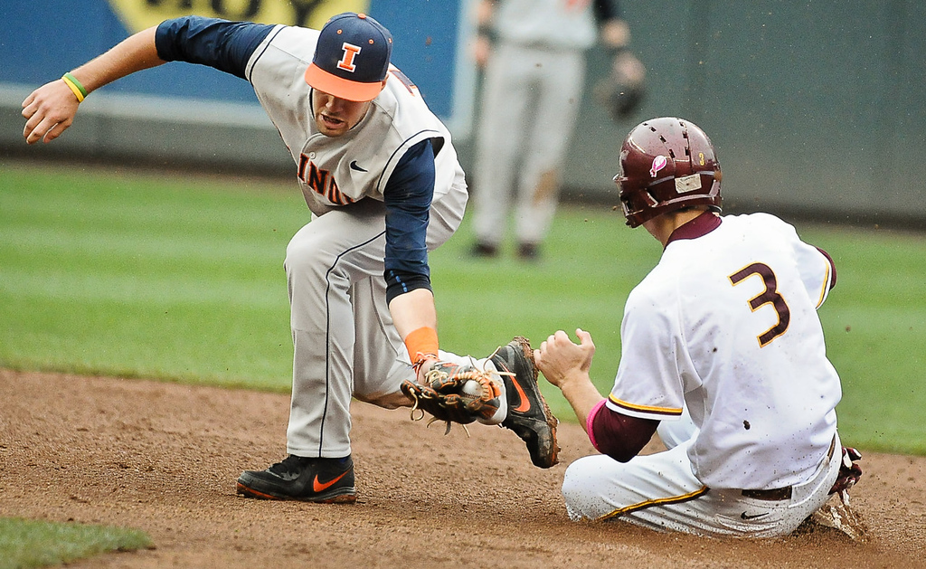 . Illinois shortstop Thomas Lindauer tags Minnesota\'s Troy Larson out at second base as he tries to advance on a bunt in the seventh inning.  (Pioneer Press: Ben Garvin)