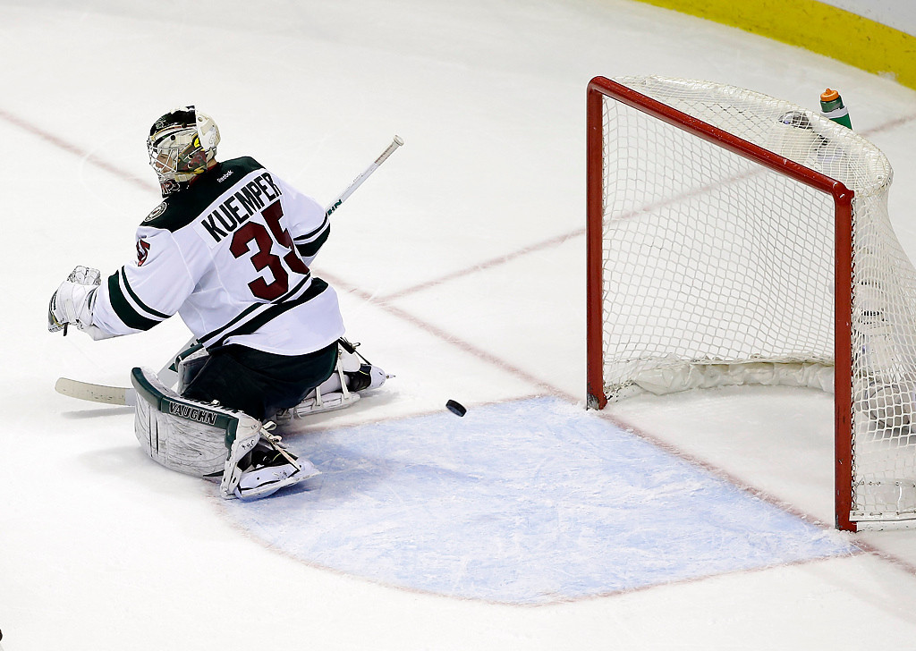 . Minnesota Wild goalie Darcy Kuemper is beaten for the game-winning goal on a shot by San Jose Sharks\' Joe Thornton during overtime of an NHL hockey game on Saturday, Jan. 25, 2014, in San Jose, Calif. San Jose won 3-2 in overtime. (AP Photo/Marcio Jose Sanchez)