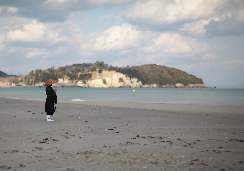 . A buddhist monk offers prayers around 2:46 p.m., the time at which the magnitude 9.0 earthquake struck at Shobuta beach on March 11, 2014 in Shichigahama town, Miyagi Prefecture, Japan. On March 11 Japan commemorates the third anniversary of the magnitude 9.0 earthquake and tsunami that claimed more than 18,000 lives, and subsequent nuclear disaster at the Fukushima Daiichi Nuclear Power Plant.  (Photo by Yuriko Nakao/Getty Images)