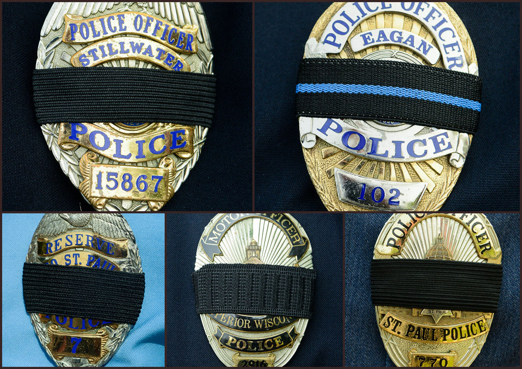. Police officers from around the region arrive for police officer Scott Patrick\'s funeral services wearing black bands over their badges.  (Pioneer Press: Ben Garvin)