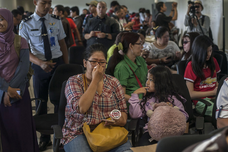. Family members of passengers of missing Malaysian air carrier AirAsia flight QZ8501 gather at Juanda international airport in Surabaya in East Java on December 28, 2014 hours after the news the flight went missing. The AirAsia Airbus plane with 162 people on board went missing en route from Indonesia to Singapore early on December 28, officials and the airline said, in the third major incident to affect a Malaysian carrier this year.   JUNI KRISWANTO/AFP/Getty Images