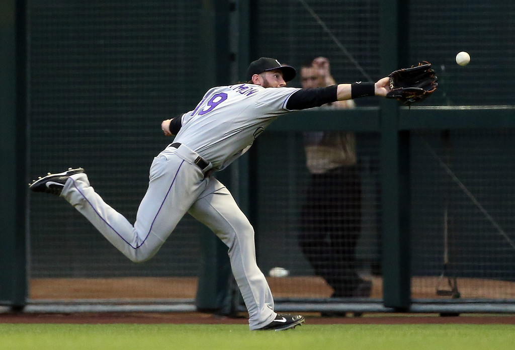 . Outfielder Charlie Blackmon #19 of the Colorado Rockies is unable to catche a triple hit by Martin Prado (not pictured) of the Arizona Diamondbacks during the first inning of the MLB game at Chase Field on April 30, 2014 in Phoenix, Arizona.  (Photo by Christian Petersen/Getty Images)