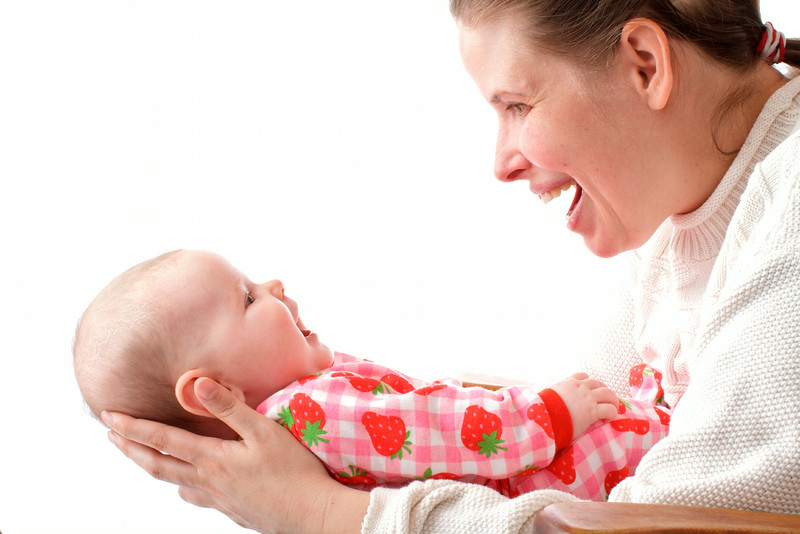 Mother  and baby laugh at each other