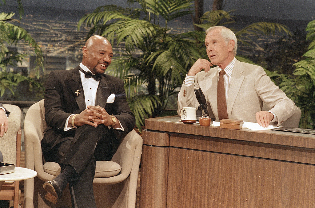 ". Middleweight boxing champion ""Marvelous\"" Marvin Hagler, left, talks to NBC-TV\'s Tonight Show host Johnny Carson about his boxing career Tuesday, May 14, 1986 in Burbank, Calif. He said he would announce next month if he will accept a challenge from \""Sugar\"" Ray Leonard to meet in the ring. (AP Photo)"