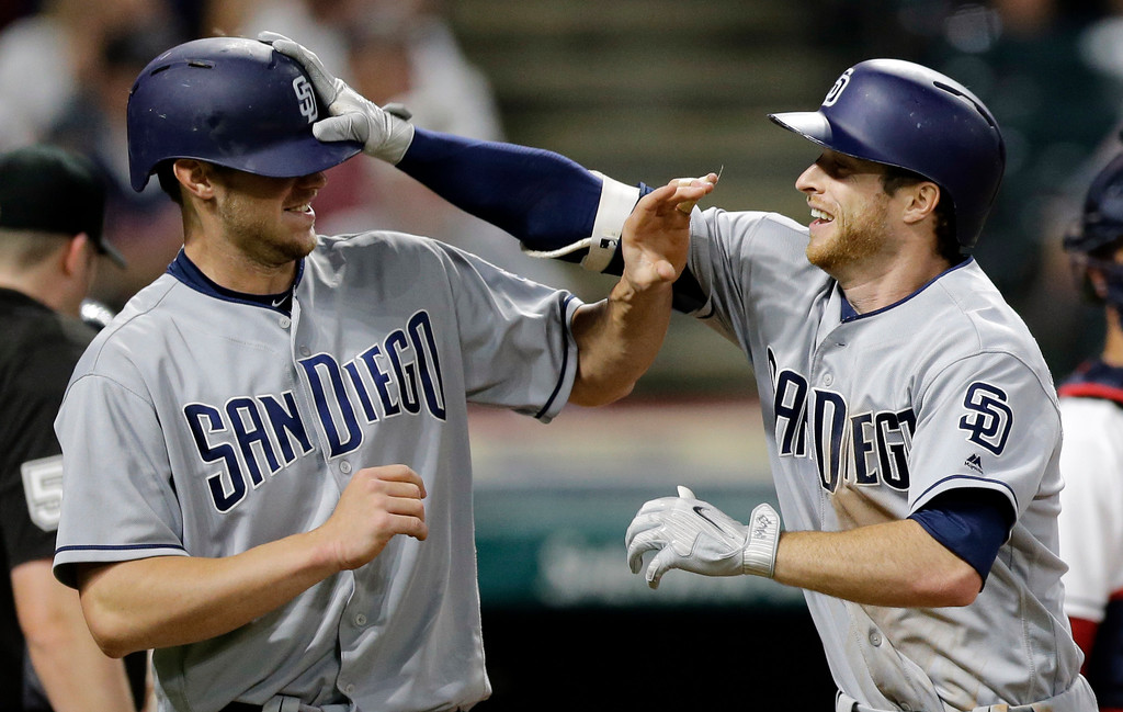 . San Diego Padres\' Cory Spangenberg, right, grabs Wil Myers\'s helmet after Spangenberg hit a two-run home run off Cleveland Indians relief pitcher Zach McAllister in the seventh inning of a baseball game, Wednesday, July 5, 2017, in Cleveland. Myers scored on the play. (AP Photo/Tony Dejak)