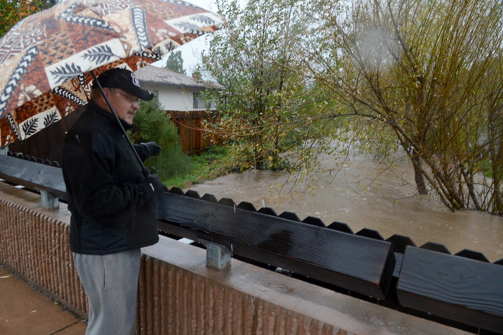. Kenny Hindmon watches high water in the creek by his home in Novato, Calif., on Thursday, Dec. 11, 2014. (Alan Dep/Marin Independent Journal)