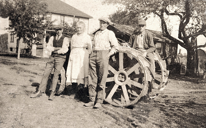 Grandpa & Grandma Rutkowske with there New Tractor 1920-30.JPG