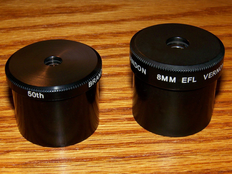 Here is a pair of recent Brandon eyepieces. 6mm and 8mm. They have an interesting story. The 6mm (left)  is part of the recent 50th Anniversary set. The 8mm on the right was meant to be one of gold anodized series of Brandon sets, but the owner of Vernoscope Don Yeir as I am told had too many 1.25 barrels gold anodized as the number of eyepieces were limited to only 100. This one was gold plated by mistake. It went back to the coating company and the plating was removed and recoated the proper black. The barrel was fitted with the 8mm optics and now has a slightly duller finish to it upon close inspection. So even though it now is only a standard Brandon 8mm it once had the distinction of once being a gold plated Brandon ocular!