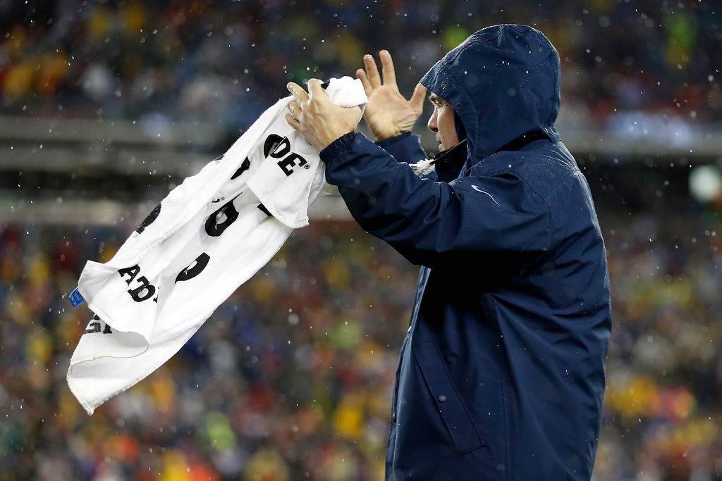 . New England Patriots head coach Bill Belichick reacts to a call during the second half of an AFC divisional NFL playoff football game against the Indianapolis Colts in Foxborough, Mass., Saturday, Jan. 11, 2014. (AP Photo/Michael Dwyer)