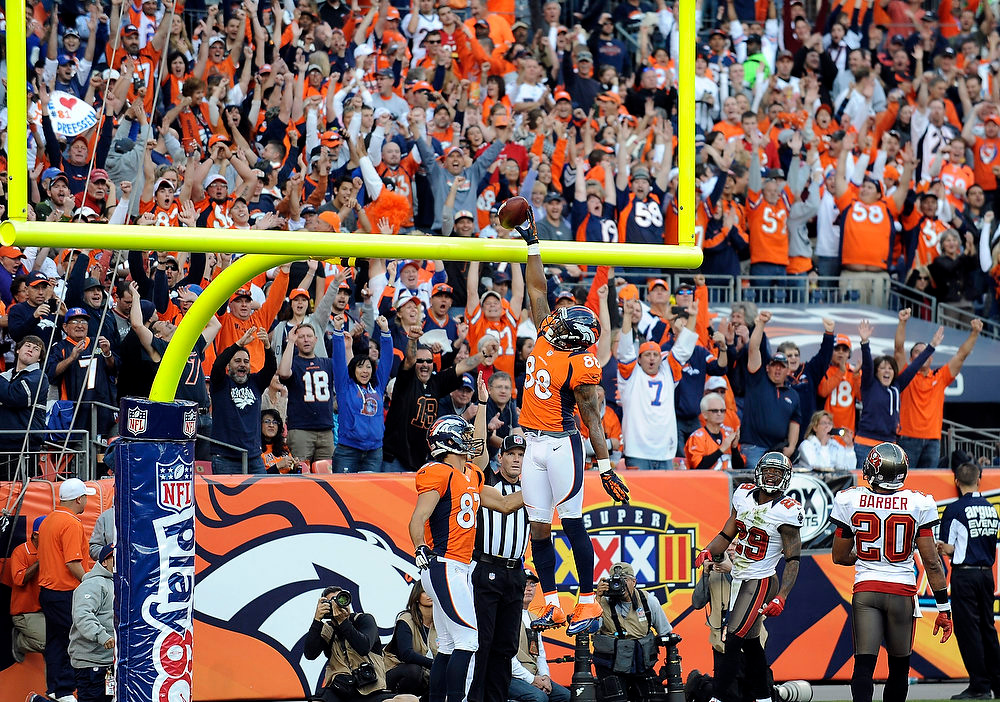 . DENVER - Denver Broncos wide receiver Demaryius Thomas dunks the ball over the goalpost after scoring a touchdown in the third quarter against Tampa Bay Sunday at Sports Authority Field. Steve Nehf, The Denver Post