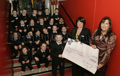 Carmel Campbell Nursing Director SAH recieves a cheque from the Primary 4 class at St Malachy's P.S. for £1600 money raised through a Christmas raffle held in the school. Also pictured is Primary 4 Teacher Sonia McPolin. 07W4N14