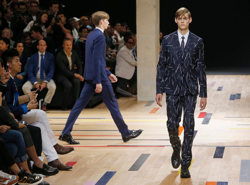 . Models wear creations by Belgian designer Kris Van Assche as part of Dior Homme menís Spring-Summer 2015 fashion collection, presented in Paris, Saturday, June 28, 2014. (AP Photo/Jacques Brinon)