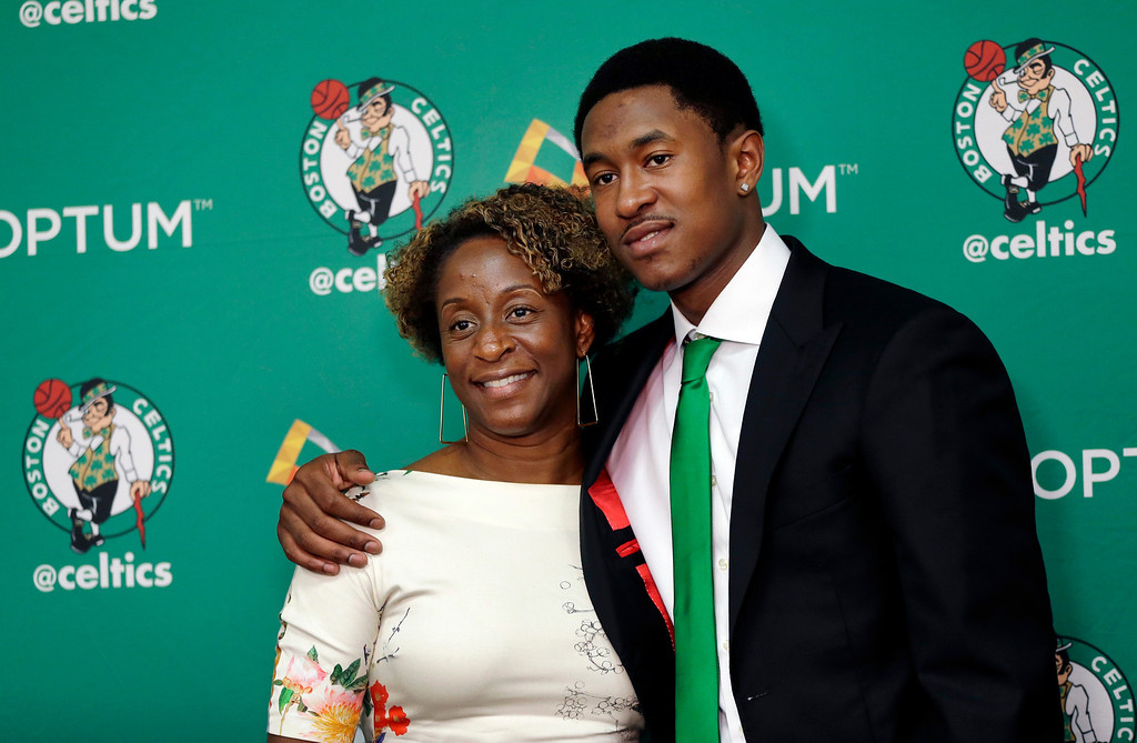 . Newly acquired Boston Celtics player MarShon Brooks, right, poses for a photo with his mother, Darlyn, in Waltham, Mass., Monday, July 15, 2013, after an NBA basketball news conference to introduce players the team acquired from the Brooklyn Nets in exchange for Kevin Garnett and Paul Pierce. (AP Photo/Elise Amendola)