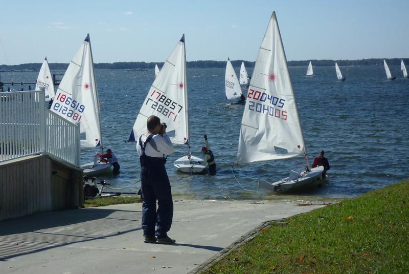 Jon Deutsch taking photos of the sailors launching.