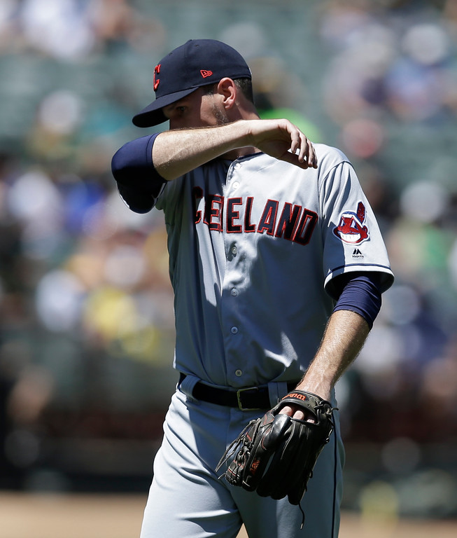 . Cleveland Indians pitcher Dan Otero wipes his face as he is removed in the third inning of a baseball game against the Oakland Athletics, Sunday, July 16, 2017, in Oakland, Calif. (AP Photo/Ben Margot)
